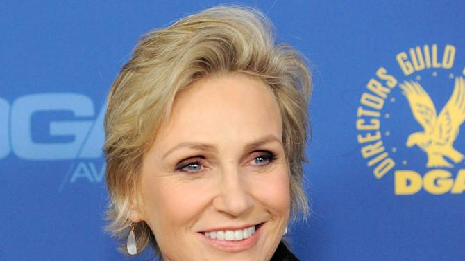 "FILE - This Feb. 2, 2013 file photo shows actress Jane Lynch at the 65th Annual Directors Guild of America Awards in Los Angeles. Lynch has been named as host of NBC's ""Hollywood Game Night"" that features A-list celebrities hanging out and playing games with fun-loving non-celebrity contestants in a cocktail party atmosphere.  (Photo by Chris Pizzello/Invision/AP, file)"