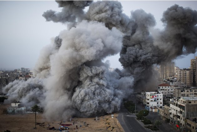 Smoke rises after an Israeli forces strike in Gaza City, Sunday, Nov. 18, 2012. The Israeli military widened its range of targets in the Gaza Strip on Sunday to include the media operations of the Pal