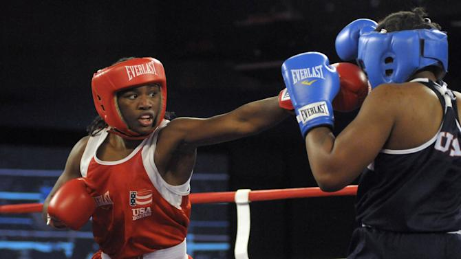 FILE - In this Saturday, Feb. 18, 2012 file photo, Claressa Shields, left, and Tika Hemingway battle during a middleweight boxing match at the U.S. Olympic women's boxing team trials in Spokane, Wash. Shields is one of a crowd of female athletes grabbing the limelight at the 2012 London Olympics Games, which are quickly shaping up as a watershed for women's sports. (AP Photo/Jed Conklin, File)