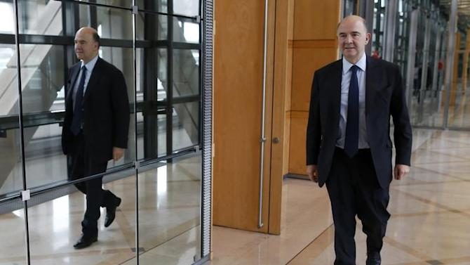 France's Finance Minister Pierre Moscovici leaves after an interview with Reuters at Bercy Finance Ministry in Paris
