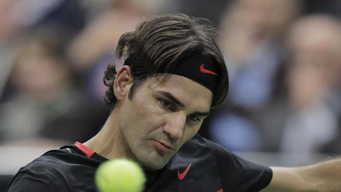 Roger Federer of Switzerland returns a shot against  Juan Martin del Potro of Argentina during the final at the ABN AMRO tournament at the Ahoy Arena in Rotterdam, Netherlands, Sunday, Feb. 19, 2012. Federer won in two sets 6-1, 6-4. (AP Photo/Peter Dejong)