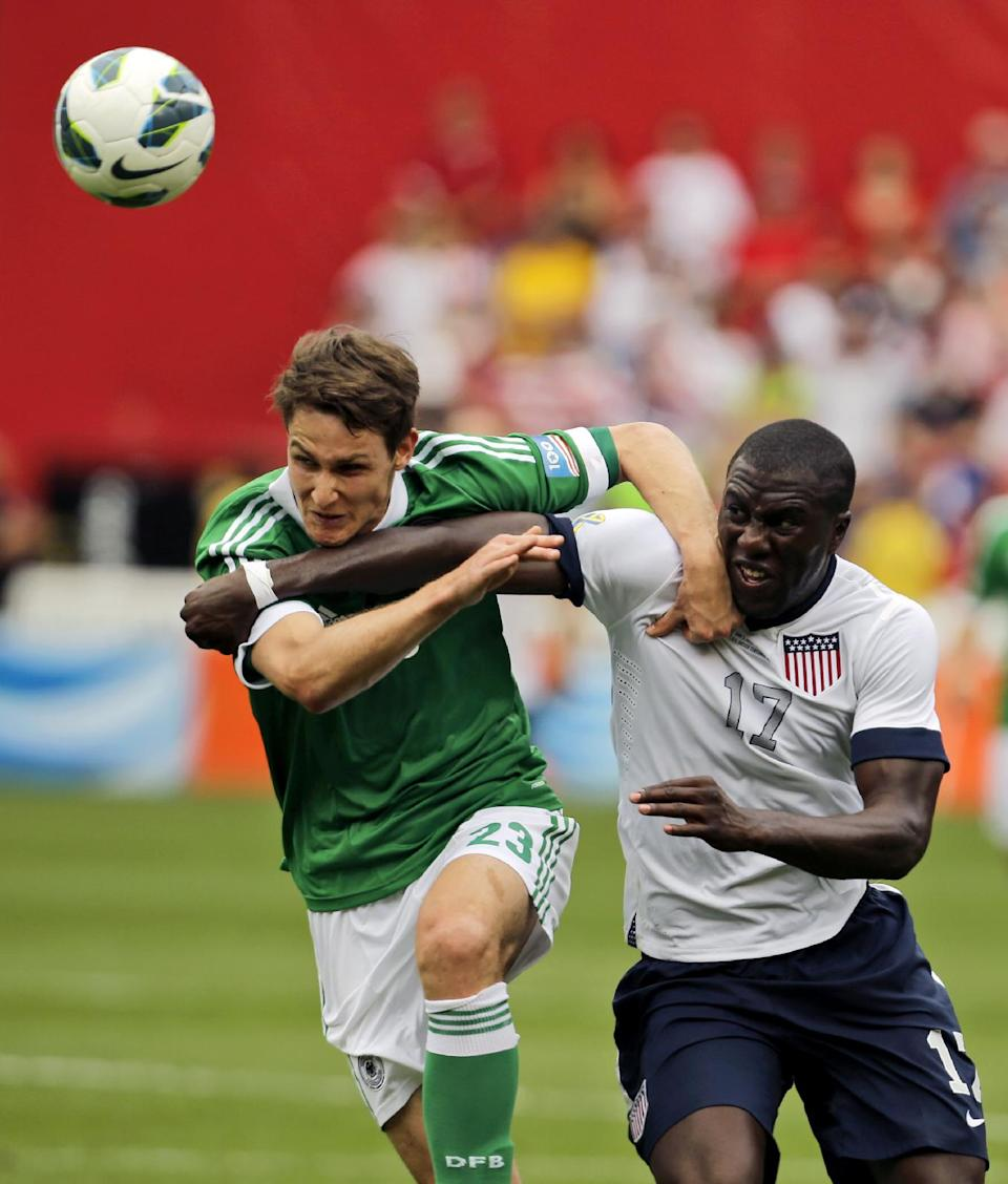 Germany defenseman Philipp Wollscheid (23) and U.S. forward Jozy Altidore (17) battle for the ball during the second half of an international friendly soccer match at RFK Stadium, Sunday, June 2, 2013, in Washington. The U.S. won 4-3. (AP Photo/Alex Brandon)