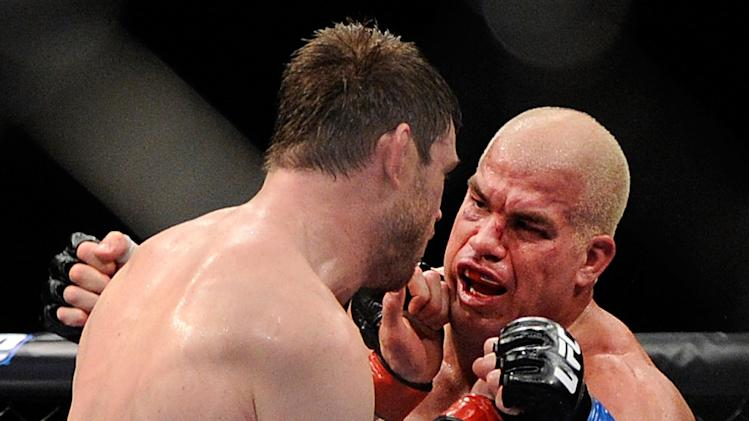 Tito Ortiz, right, and Forrest Griffin battle it out during their UFC 148 light heavyweight fight, Saturday, July 7, 2012, in Las Vegas. (AP Photo/David Becker)