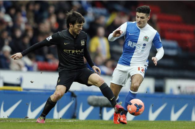 Manchester City's Silva challenges Blackburn Rovers' Marshall during their FA Cup third round soccer match at Ewood Park in Blackburn, northwest England