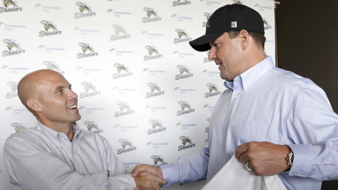Roger Clemens, right, shakes hands with team president Matt O'Brien, left, while posing for photographers after a news conference officially announcing his signing with the Sugar Land Skeeters baseball team Tuesday, Aug. 21, 2012, in Sugar Land, Texas. Clemens, a seven-time Cy Young Award winner, signed with the Skeeters of the independent Atlantic League on Monday and is expected to start for the minor league team on Saturday at home against Bridgeport. (AP Photo/David J. Phillip)