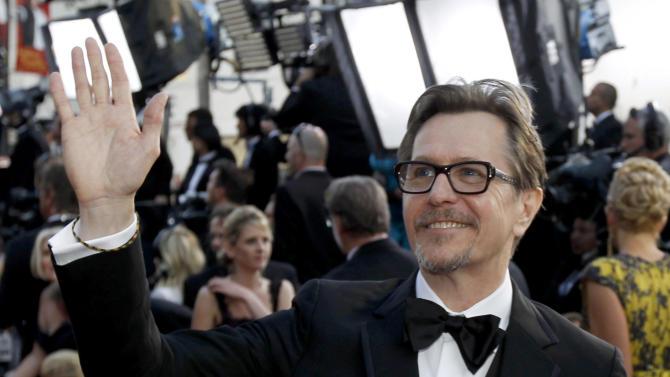 Michel Hazanavicius arrives before the 84th Academy Awards on Sunday, Feb. 26, 2012, in the Hollywood section of Los Angeles. (AP Photo/Chris Carlson)