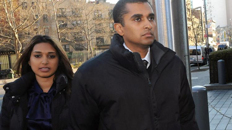 Mathew Martoma, right, former SAC Capital Advisors hedge fund portfolio manager enters Manhattan federal court, Monday, Nov. 26, 2012, in New York. Martoma was arrested on charges that he helped carry out the most lucrative insider trading scheme in U.S. history, enabling investment advisers and their hedge funds to make more than $276 million in illegal profits. (AP Photo/ Louis Lanzano)