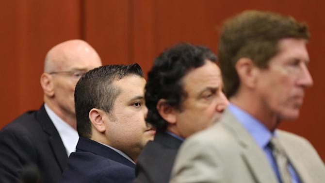 Attorney Mark O'Mara, right, jury consultant Robert Hirschhorn, second from right, George Zimmerman and co-counsel Don West, left, watch the proceedings during Zimmerman's trial in Seminole circuit court in Sanford, Fla., Tuesday, June 18, 2013. Zimmerman has been charged with second-degree murder for the 2012 shooting death of Trayvon Martin. (AP Photo/Orlando Sentinel, Joe Burbank, Pool)