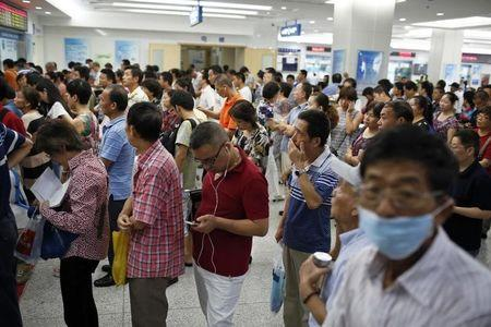 China aims to double doctor numbers as cure for healthcare woes