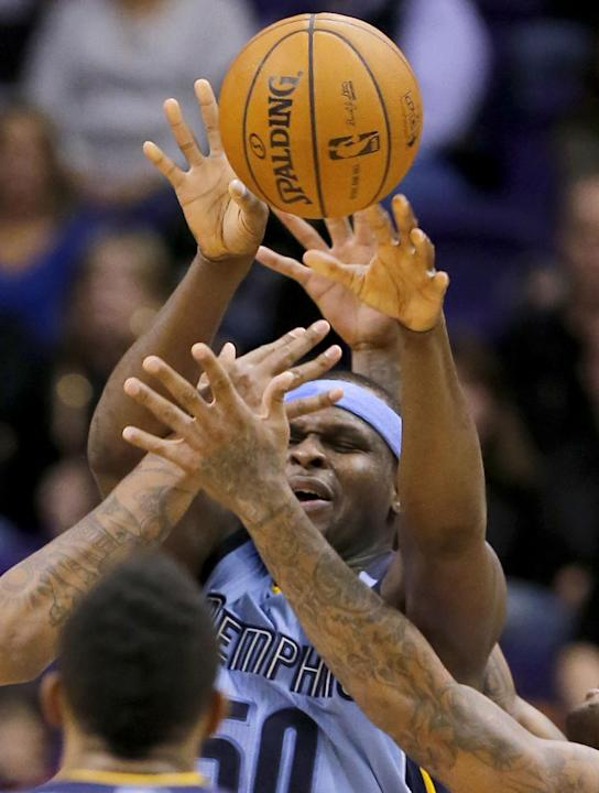 Memphis Grizzlies' Zach Randolph gets a pass off against the Phoenix Suns during the second half of an NBA basketball game on Thursday, Jan. 2, 2014, in Phoenix. The Grizzlies won 99-91