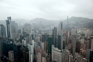 Hong Kong&#39;s skyline is seen here shrouded in a haze of pollution. Environmentalists on Wednesday expressed disappointment at new clean-air targets for Hong Kong, as research showed pollution-related illnesses killed more than 3,000 residents a year