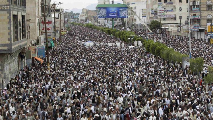 Supporters of the Shi'ite Houthi attend an anti-government rally in Sanaa