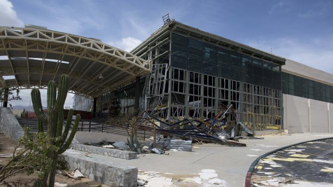 The main entrance to the airport sits heavily damaged after hurricane Odile roared past San Jose de los Cabos, Mexico, Wednesday, Sept. 17, 2014. Odile left the resort city seriously battered and mostly without power, phone service and running water. (AP Photo/Dario Lopez-Mills)