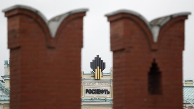 File photo shows the logo of Russia's top crude producer Rosneft at the company's headquarters, behind the Kremlin wall, in central Moscow