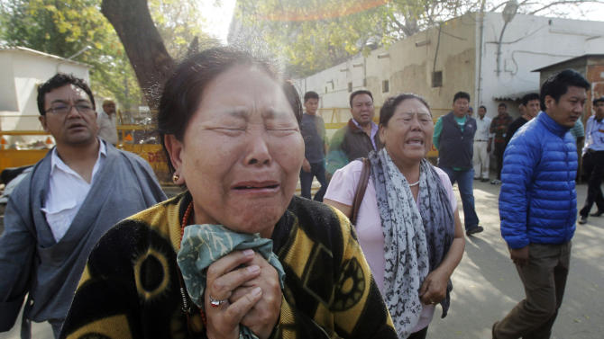 Elderly Tibetan exiles cry after viewing the body of Tibetan Jamphel Yeshi, 27, laid at a hospital morgue in New Delhi, India, Thursday, March 29, 2012. Yeshi, who burned himself alive on the eve of a visit by China's president, left behind a letter that urged the world to stand up for his homeland, activists said, while Indian authorities detained more Tibetans on Thursday in the Indian capital. (AP Photo/Rafiq Maqbool)