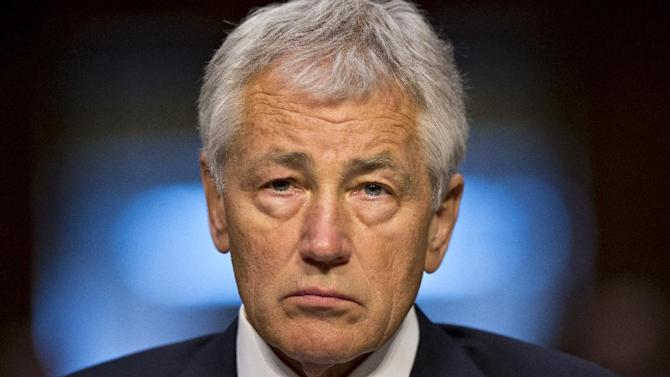 Defense Secretary Chuck Hagel listens prior to testifying on Capitol Hill in Washington, Wednesday, April 17, 2013, before the Senate Armed Services Committee hearing on the Pentagon's budget for fiscal 2014 and beyond.  (AP Photo/J. Scott Applewhite)