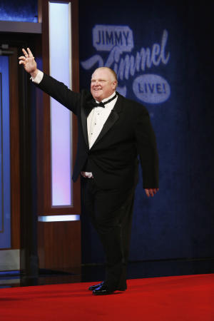 "FILE - In this Sunday, March 2, 2014, file photo, provided by ABC, Toronto Mayor Rob Ford appears on the 9th annual ""Jimmy Kimmel Live: After the Oscars"" Special on the ABC broadcast from Disney's El Capitan Theater located on Hollywood Boulevard, in Los Angeles. The studio is just steps away from Dolby Theater, home to the Academy Awards. Ford also appeared on Kimmel's show on Monday night, March 3, and it was the culmination of months of wooing by the talk show host to get Ford to appear as a guest. (AP Photo/ABC, Randy Holmes, File)"