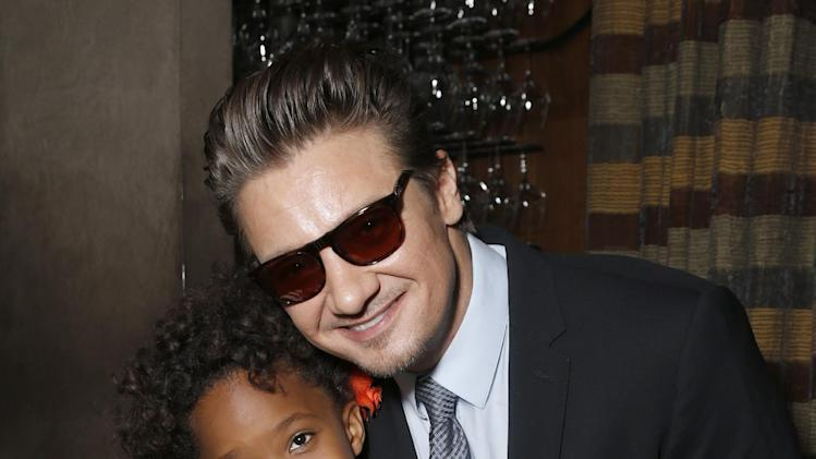 Quvenzhane Wallis and Jeremy Renner attend the Film Independent Spirit Awards Luncheon at BOA Steakhouse on Saturday, Jan. 12, 2013, in West Hollywood, Calif. (Photo by Todd Williamson/Invision/AP)