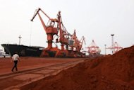 File photo shows rare earth being loaded on to a ship at a port in Lianyungang, east China's Jiangsu province. China said Wednesday its regulation of the rare earths industry was in line with international rules as it faces international pressure over its control of the crucial elements