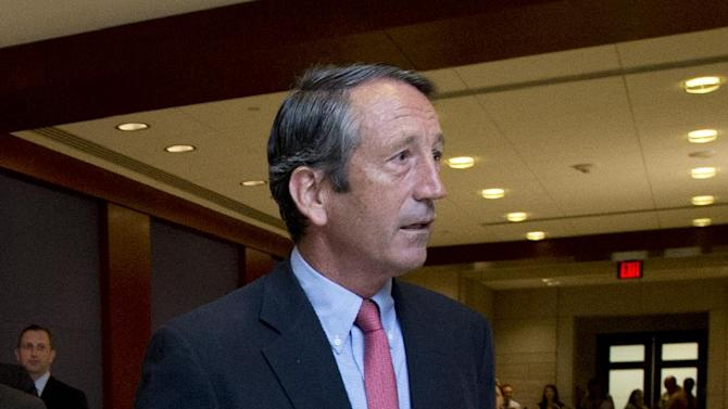 Rep. Mark Sanford, R-S.C., arrives for a closed all-member briefing on the NSA on Capitol Hill in Washington, Tuesday, June 11, 2013.    (AP Photo/Manuel Balce Ceneta)
