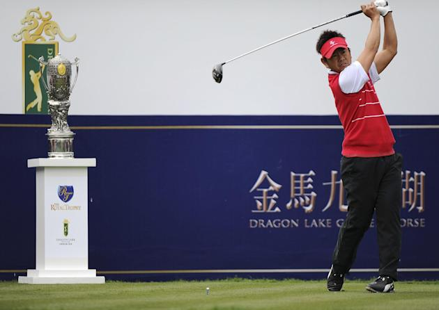 Hiroyuki Fujita of Japan tees off on the first hole during the Foursomes Match between European team's Nicolas Colsaerts of Belgium, Bernd Wiesberger of Austria and Asian team's Ryo Ishikawa a