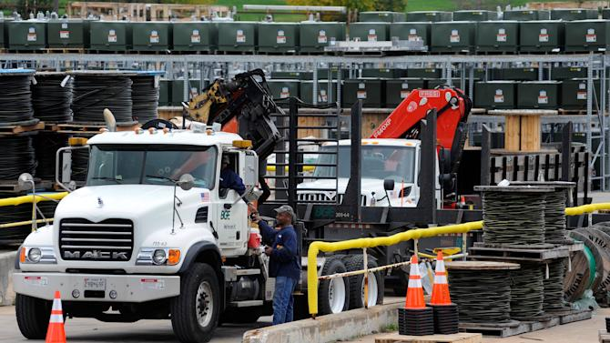 Baltimore Gas & Electric (BGE) workers talk at a BGE storage yard in Baltimore Friday, Oct. 26, 2012. Utilities and governments on the East Coast are preparing for Hurricane Sandy, which is expected to bring extreme weather to the region beginning Sunday. (AP Photo/Steve Ruark)