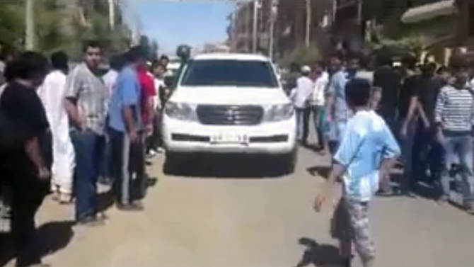This image made from amateur video released by Shaam News Network and accessed Tuesday, June 12, 2012 purports to show a UN observer vehicle surrounded by civilians in Deir el-Zour, Syria.(AP Photo/Shaam News Network via AP video)THE ASSOCIATED PRESS CANNOT INDEPENDENTLY VERIFY THE CONTENT, DATE, LOCATION OR AUTHENTICITY OF THIS MATERIAL