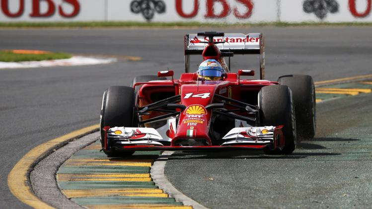 Ferrari Formula One driver Alonso of Spain drives during the third practice session of the Australian F1 Grand Prix in Melbourne