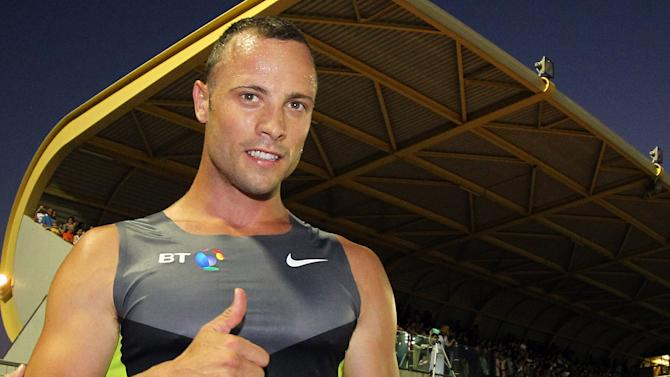 Double-amputee sprinter, South African Oscar Pistorius, poses for photographers at the end of a 400 meter race in Lignano Stadium, near Udine, northern Italy, Tuesday, July 17, 2012. Pistorius, known globally as the Blade Runner, will be running the 400 meters race at the London 2012 Olympic Games. The South African was selected by his country as the first amputee athlete to run at the Olympics and wants desperately to prove himself at the games after eventually being cleared to run against able-bodied athletes on his blades. (AP Photo/Paolo Giovannini)
