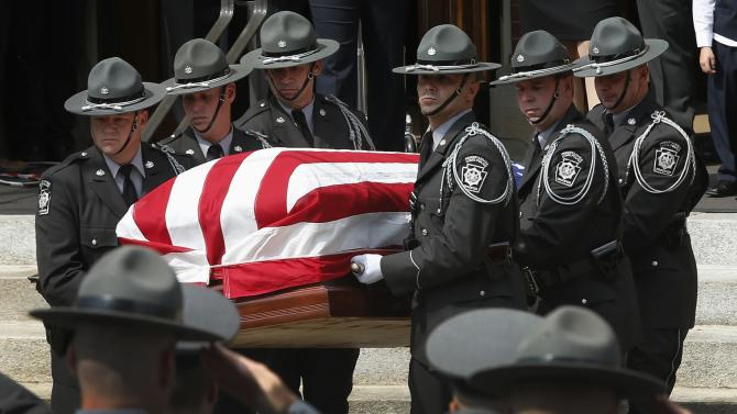 Pennsylvania State Police Troopers carry the casket of slain Pennsylvania State Police Trooper Corporal Bryon Dickson, 38, from St. Peters' Cathedral, following his funeral service in Scranton