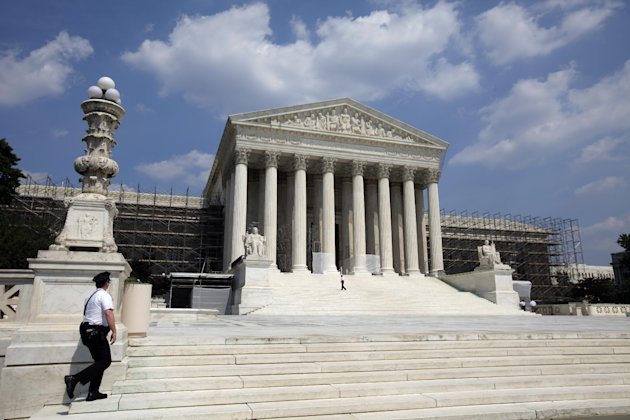 FILE - This June 20, 2012, file photo shows the U.S. Supreme Court in Washington. It's the biggest secret in a city known for not keeping them: the nine Supreme Court justices and more than three dozen other people have kept quiet for more than two months about how the high court is going to rule on the constitutionality of President Barack Obama's health care overhaul. (AP Photo/Alex Brandon)