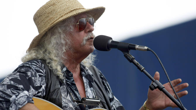 FILE - In this Aug. 2, 2009 file photo, Arlo Guthrie performs at George Wein's Newport Folk Festival in Newport, R.I.  Guthrie is scheduled to play again at the 2012 Newport Folk Festival. (AP Photo/Joe Giblin, File)