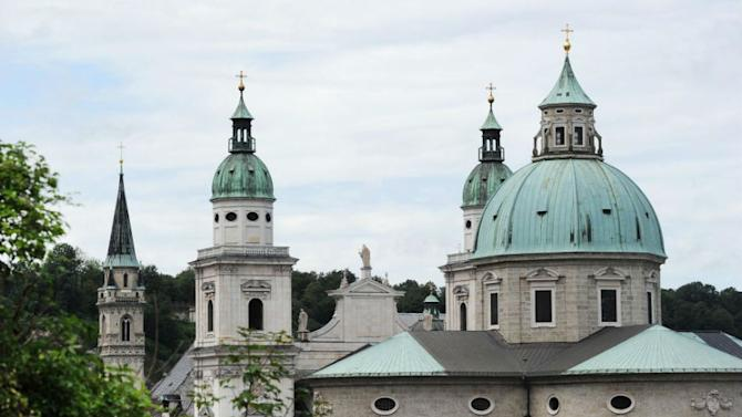 The steeples of Salzburg cathedral and the Franciscan church (L) in Salzburg, Austria. The Salzburg Festival is a prominent festival of music and drama established in 1920 and is held each summer within the Austrian town of Salzburg, the birthplace of Wolfgang Amadeus Mozart.