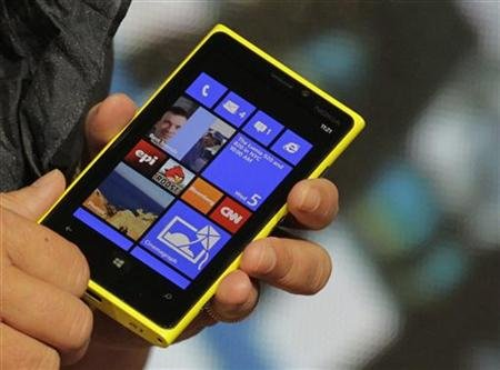 A Nokia executive shows the new Lumia 920 phone with Microsoft's Windows 8 operating system at a launch event in New York