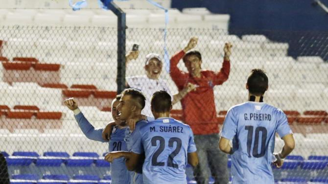 Uruguay's Acosta celebrates after scoring a goal against Peru during their South American Under-20 Championship soccer match in Montevideo