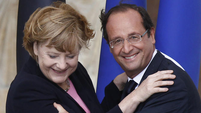"""FILE - In this July 8, 2012 file photo German Chancellor Angela Merkel, left, and French President Francois Hollande react after a speech in front of  Reims cathedral, in Reims, eastern France. Merkel and Hollande said in a joint statement issued by the German government Friday, July 27, 2012 that their countries are """"deeply committed to the integrity of the eurozone."""" They said eurozone members and European institutions """"must comply with their obligations, each in their own are of competence."""" (AP Photo/Pool/Jacky Naegelen, File)"""