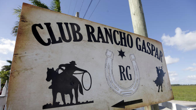 In this photo taken Saturday, July 6, 2013, a sign is shown outside the Club Rancho Gaspar where athletes were competing in a coleo, a Latin American style rodeo, in Hialeah, Fla. The scene is reminiscent of rodeos that happen in countless Venezuelan and Latin American towns. The athletes are competing to represent the U.S. in a world bull tripping championship that will take place in Venezuela later this year. (AP Photo/Lynne Sladky)