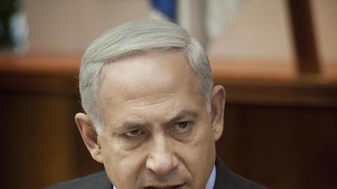 "Israeli Prime Minister Benjamin Netanyahu chairs the weekly cabinet meeting at the Prime Minister's Office in Jerusalem, Sunday, Aug. 12, 2012. With attack rhetoric heating up, Israel's prime minister says the threat from Iran dwarfs all others. Netanyahu told his Cabinet on Sunday, ""Iran must not be allowed to obtain nuclear weapons."" (AP Photo/Abir Sultan, Pool)"