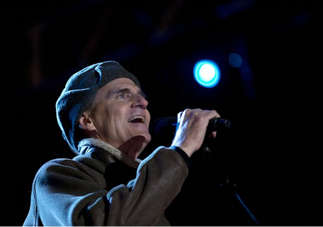 FILE - In this Dec. 6, 2012 file photo, Singer James Taylor performs for President Barack Obama and the First Family during  the annual National Christmas Tree Lighting on the Ellipse, in Washington.