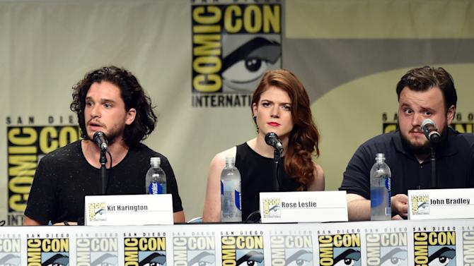 "(L-R) Actors Kit Harington, Rose Leslie and John Bradley at the ""Game Of Thrones"" panel during Comic-Con International in San Diego on July 25, 2014"