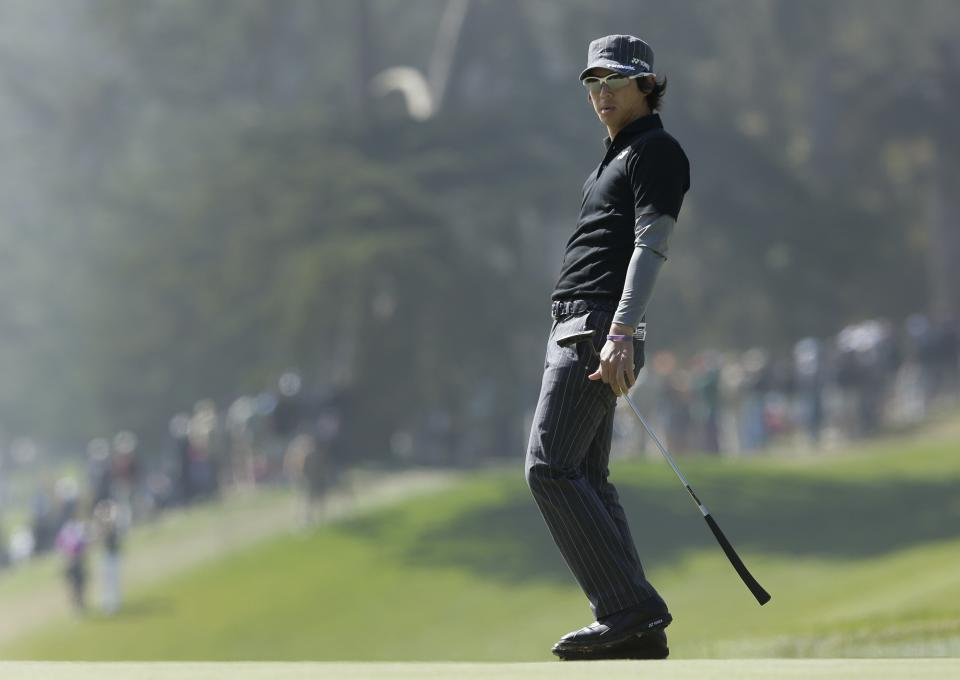 Ryo Ishikawa, of Japan, reacts after missing a birdie on the fourth hole during the second round of the U.S. Open Championship golf tournament Friday, June 15, 2012, at The Olympic Club in San Francisco. (AP Photo/Charlie Riedel)
