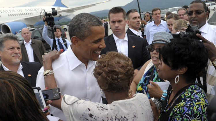 President Barack Obama greets people after arriving at Roanoke Regional Airport in Roanoke, Va., Friday, July 13, 2012. Obama is spending the day campaigning in Virginia. (AP Photo/Susan Walsh)