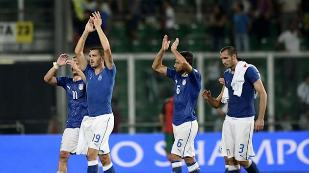 Italy's players celebrate at the end of their World Cup qualifying soccer match against Bulgaria at the Renzo Barbera Stadium in Palermo September 6, 2013 (Reuters)
