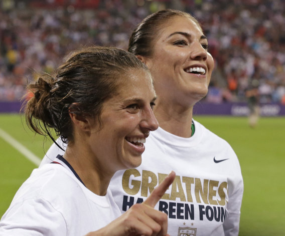United States' Carli Lloyd, celebrates with teammate Hope Solo, right, after winning the gold medal match against Japan at the 2012 Summer Olympics, Thursday, Aug. 9, 2012, in London. The U.S. women's football team won its third straight Olympic gold medal Thursday, beating Japan 2-1 in a rematch of last year's World Cup final and avenging the most painful loss in its history. (AP Photo/Ben Curtis)