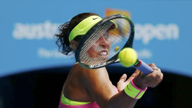 Keys of the U.S. hits a return to compatriot Venus during their women's singles quarter-final match at the Australian Open 2015 tennis tournament in Melbourne