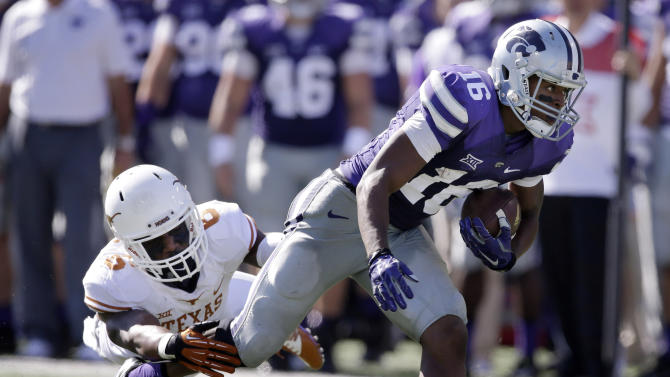 FILE - Kansas State wide receiver Tyler Lockett (16) breaks a tackle by Texas cornerback Quandre Diggs (6) during the second half of an NCAA college football game in Manhattan, Kan., in this Oct. 25, 2014 file photo. K-State still has most of its pivotal Big 12 games ahead with Baylor, West Virginia and TCU. (AP Photo/Orlin Wagner, File)