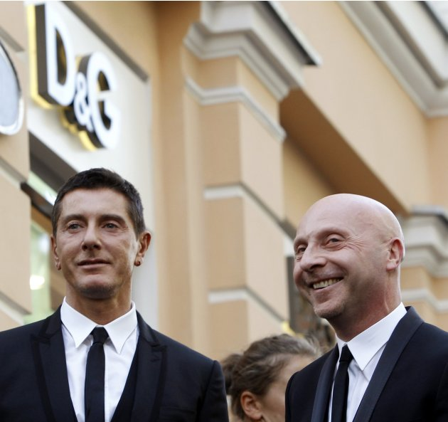 File picture shows Italian fashion designers Domenico Dolce and Stefano Gabbana posing for a picture in Moscow