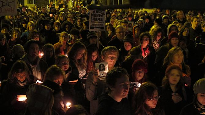 Abortion rights activists hold candles and display pictures in memory of Savita Halappanavar during a protest rally outside Ireland's government headquarters in Dublin Saturday, Nov. 17, 2012. Thousands marched to the spot to demand that the government draft a law defining when abortions can be performed to save a woman's life. Ireland has been shocked by the death of Halappanavar, a 31-year-old Indian dentist who died of blood poisoning after being denied an abortion in a Dublin hospital last month. (AP Photo/Shawn Pogatchnik)