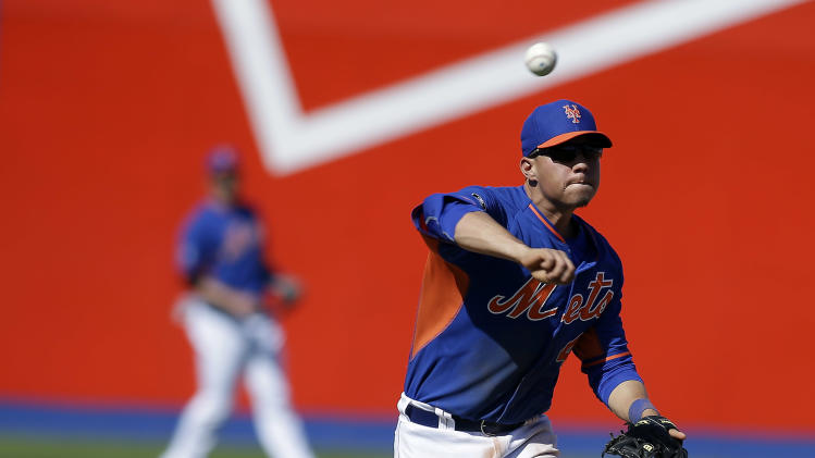 New York Mets shortstop Wilmer Flores throws to first during a spring exhibition baseball game against the Chicago Cubs, Sunday, March 16, 2014, in Las Vegas