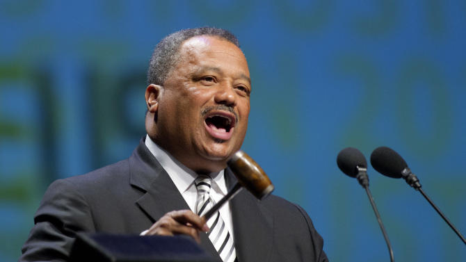 Fred Luter, Jr. , President of the Southern Baptist Convention, and senior pastor of the Franklin Ave Baptist Church in New Orleans speaks to members Wednesday, June 12, 2013, in Houston. The Southern Baptist Convention approved a resolution Wednesday expressing its opposition to the Boy Scouts of America's new policy allowing gay Scouts, though it doesn't explicitly call for churches to drop all ties with the organization.(AP Photo/Bob Levey)